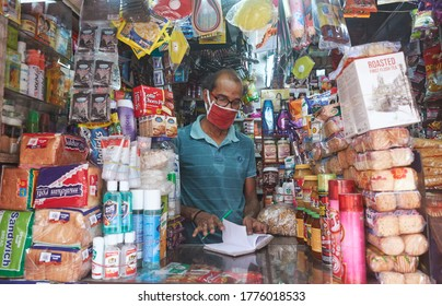 Kolkata, India, 7/12/2020: A middle aged shop owner, wearing facemask inside his stationery shop. During Unlock 3.0, due to easing lockdown restrictions, more number of shops are gradually opening.