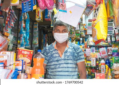 Kolkata, India, 7/5/2020: A middle aged shop owner, wearing facemask inside his stationery shop. During Unlock 3.0, due to easing lockdown restrictions, more number of shops are gradually opening.