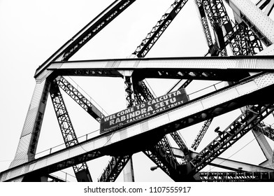 KOLKATA, INDIA - APRIL 07, 2018: the structure of the metal bridge along side the hooghly river in Kolkata as black and white
