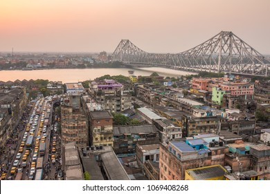 Kolkata, India - April 13, 2017: Beautiful view of Kolkata city with a Howrah bridge on the river Hooghly during sunset.