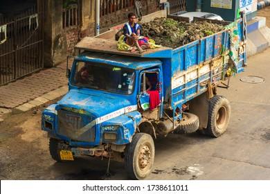 Kolkata, India - April 2020: Lockdown for COVID-19 - Man sitting on top of a truck