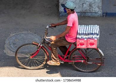 Kolkata, India - April 2020: Lockdown for COVID-19 - Man Carrying Juice