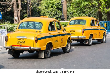 Kolkata, India - April 25th 2017:Iconic yellow Indian taxi in Calcutta (Kolkata) India. The Ambassador taxi vehicle is no longer being built but thousands remain on the streets of many Indian cities