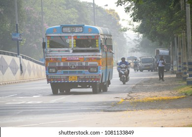 Kolkata, India - April 30, 2017: A government bus travelling down the road amidst smog.