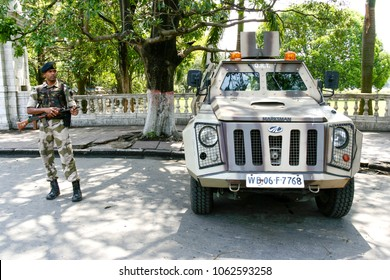 Kolkata, India - April 6, 2018 : young indian soldier guard holding light machine gun and marksman armoured vehicle are observed for anti-terrorism in Kolkata, India.