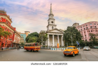 Kolkata, India, December 15,2018: City traffic in front of old St. Andrews Kirk (church) at Dalhousie area of Kolkata early morning at sunrise
