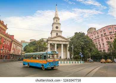 Kolkata, India, December 16,2018: City public transport bus in front of old St. Andrews Kirk (church) at Dalhousie area of Kolkata early morning