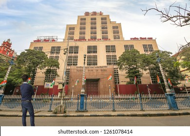 Kolkata, India, December 16,2018: Young man looking at the Reserve Bank of India building at Dalhousie area of Kolkata with view of early morning city road