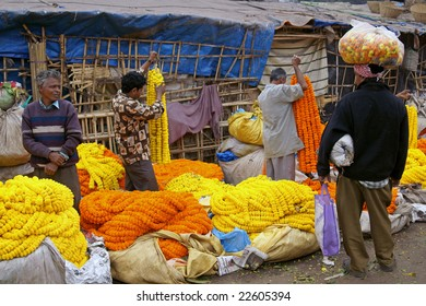 KOLKATA, INDIA - DECEMBER 18: Unknown people buying and selling flowers at the flower market in the shadow of the Haora Bridge on 18 December 2008 in Kolkata, West Bengal, India