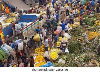 KOLKATA, INDIA - DECEMBER 18: Unknown people at the busy flower market in the shadow of the Haora Bridge on 18 December 2008 in Kolkata, West Bengal, India