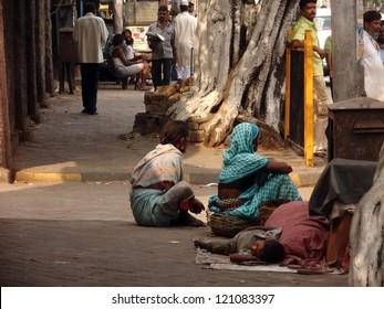 KOLKATA, INDIA - DECEMBER 3: Indian people beg on a street on December 3, 2012 in Kolkata. India contains large number of people living below the poverty line.