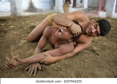 KOLKATA - INDIA - DECEMBER 6, 2017: Unidentified pehlwan wrestlers in a kushti akhara on December 6, 2017 in Kolkata, India. Kushti is a traditional form of wrestling in India.