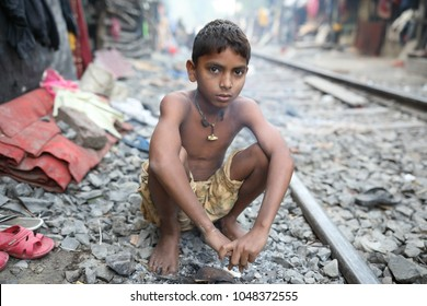 KOLKATA - INDIA - DECEMBER 7, 2017: Unidentified street child in a slum on December 7, 2017 in Kolkata, India