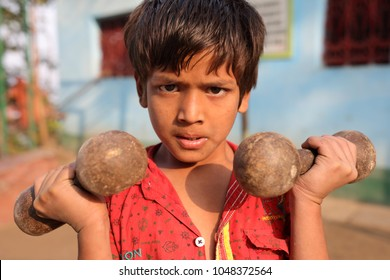 KOLKATA - INDIA - DECEMBER 7, 2017: Unidentified young pehlwan wrestler in a kushti akhara on December 7, 2017 in Kolkata, India. Kushti is a traditional form of wrestling in India.