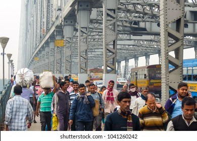 Kolkata, India - December, 8th, 2017. People crossing Howrah bridge of Kolkata.