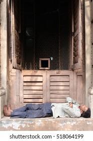 KOLKATA, INDIA - FEBRUARY 10: Homeless person sleeping on the footpath of Kolkata, India on February 10, 2016.