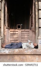 KOLKATA, INDIA - FEBRUARY 10: Homeless people sleeping on the footpath of Kolkata, India on February 10, 2016.