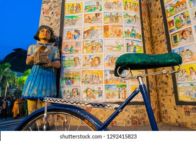 KOLKATA, INDIA - FEBRUARY 11TH , 2018 : Sculpture of a Girl child, her cycle and her books on display for promotion of books at Kolkata book fair. It is world's largest and most attended book fair.