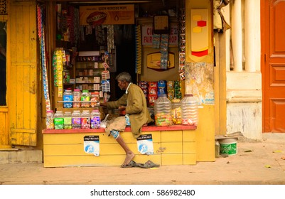 Kolkata, India - February 19, 2017: A old man selling wide variety of stationery items in his shop.