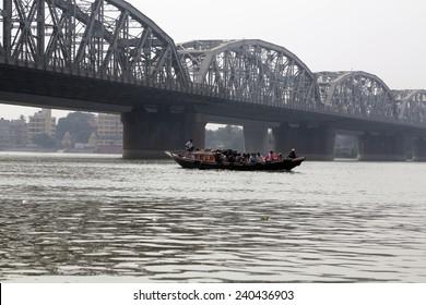 KOLKATA, INDIA - FEBRUARY 2014: Bridge across the river, Vivekananda Setu. It links the city of Howrah, at Bally, to its twin city of Kolkata, at Dakshineswar.