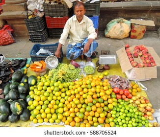 Kolkata, India - February 26, 2017: A street vendor selling fruits and vegetables in the market.