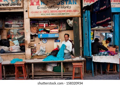 KOLKATA, INDIA - JAN 10: Tailors sew clothes in small workshops in the street of old city on January 10, 2013 in Calcutta. 15.49% of the Kolkata's workforce employed in industrial and manufacturing
