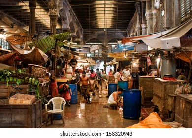 KOLKATA, INDIA - JAN 10: Workers and traders of the old city market clean counters and wash the floor on January 10, 2012 in Calcutta. Only 0.81% of Kolkata's workforce employed in agriculture