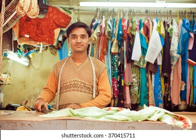 KOLKATA, INDIA - JAN 10: Young tailor sews clothes in a workshop for making dresses on January 10, 2016. Third biggest indian city Kolkata with suburbs is home to approximately 14 mill.people