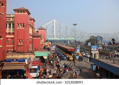 KOLKATA, INDIA -JAN 11 :Crowd of people going out from the Railway station in the background of Howrah bridge on January 11, 2018 in Kolkata, West Bengal,India.