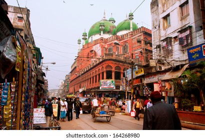 KOLKATA, INDIA - JAN 13: People move on busy street past Nakhoda Masjid mosque on January 13, 2012 in Kolkata. The total cost incurred for the Mosque construction was 1,500,000 Indian rupees in 1926