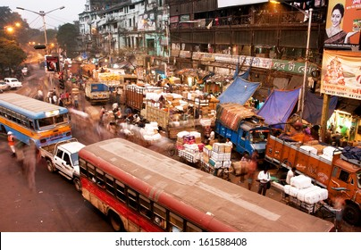 KOLKATA, INDIA - JAN 17: Blured in motion busy street with cars, buses and people traffic at evening on January 17, 2013 in Kolkata, India. Kolkata has a density of 814.80 vehicles per km road length