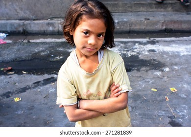 KOLKATA, INDIA - JAN 17: Unidentified child looks calm and happy on January 17, 2012 in West Bengal. Kolkata's literacy rate of 87.14% exceeds the all-India average of 74%.