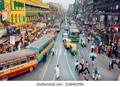 KOLKATA, INDIA - JAN 18: Crowd of busy businessmen, busses, cars on streets of huge indian city on January 18, 2013 in India. Kolkata is commercial and educational centre, with population 4,5 millions