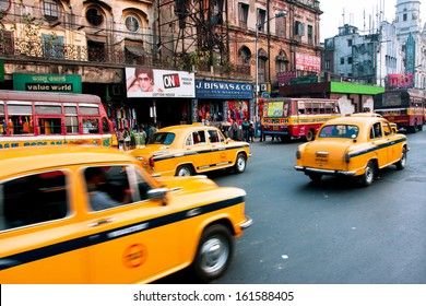 KOLKATA, INDIA - JAN 19: Yellow taxi cabs drive over speed limit on the street blurred in motion on January 19, 2013 in Kolkata, India. Kolkata has a density of 814.80 vehicles per km road length