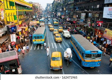 KOLKATA, INDIA - JAN 20: Lines of the yellow Ambassador taxi cabs and buses on the road of the city on January 20, 2013 in Calcutta, India. Kolkata has a density of 814.80 vehicles per km road length