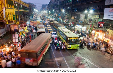 KOLKATA, INDIA - JAN 22: Dark city traffic blurred in motion at late evening on crowded streets on January 22, 2013 in Calcutta. Kolkata has a density of 814.80 vehicles per km road length