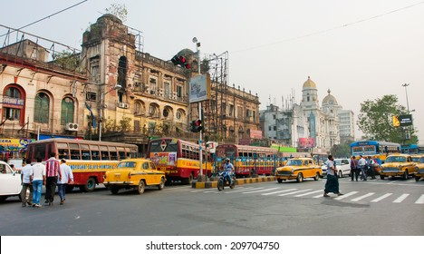 KOLKATA, INDIA - JAN 22: Panorama with traffic of taxi cars and different transport on old busy city road on January 22, 2013 in Calcutta. Kolkata has a density of 814.80 vehicles per km road length