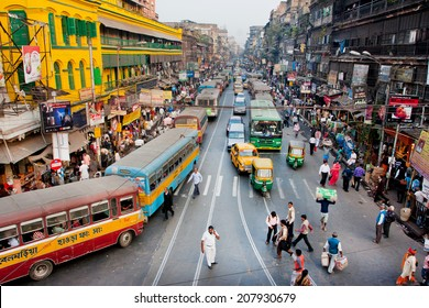 KOLKATA, INDIA - JAN 22: Traffic jam with hundreds of city taxi, buses and pedestrians of busy city road on January 22, 2013 in Calcutta. Kolkata has a density of 814.80 vehicles per km road length