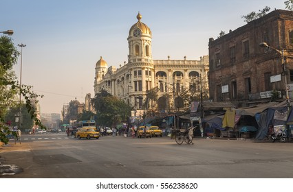 KOLKATA, INDIA -JANUARY 15, 2017: Indian city road at Esplanade Dharmatala Kolkata an important landmark with a mix of heritage buildings and architecture.