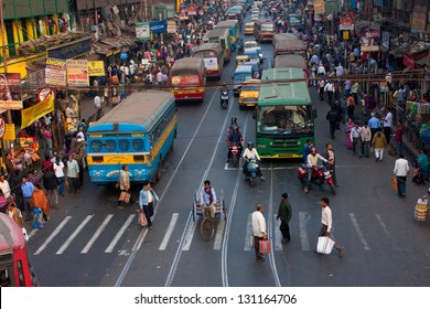 KOLKATA, INDIA - JANUARY 18: Big city street with thousands of people, bikes and the buses on January 18, 2013 in Kolkata, India. Kolkata has a density of 814.80 vehicles per km road length.