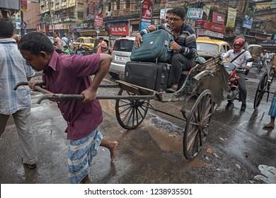 Kolkata, India, January 2008. Rickshaw puller transporting a customer through the streets of the city.