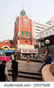 KOLKATA, INDIA - JANUARY 21: Clock tower of the historical building New Market and people around on January 14, 2013 in Kolkata, India. New Market was open with fanfare to the English populace in 1874