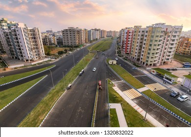 Kolkata, India, January 21,2019: City residential building apartments with adjacent roads in aerial view at sunset. Photograph shot at Newtown Rajarhat area of Kolkata, India