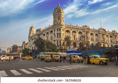 KOLKATA, INDIA -JANUARY 22, 2017:Famous Indian city road landmark Chowringhee Dharamtala crossing Kolkata with Metropolitan colonial heritage building.