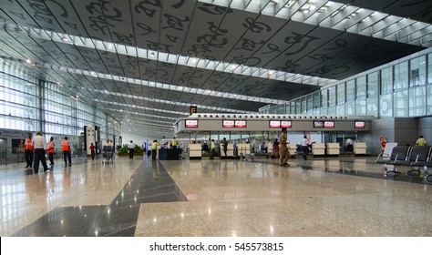 KOLKATA, INDIA - JUL 29, 2015. People waiting for check-in at Departure Hall of Netaji Subhash Chandra Bose International Airport in Kolkata, West Bengal, India.