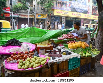 KOLKATA, INDIA - JUL 8, 2015. Street trader sell fruits outdoor in Kolkata, India. Only 0.81% of the Kolkata's workforce employed in the primary sector (agriculture).