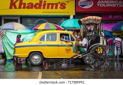 Kolkata, India - Jul 8, 2015. Traffic on street at Old Market in Kolkata, India. Kolkata is known for its grand colonial architecture art galleries and cultural festivals.