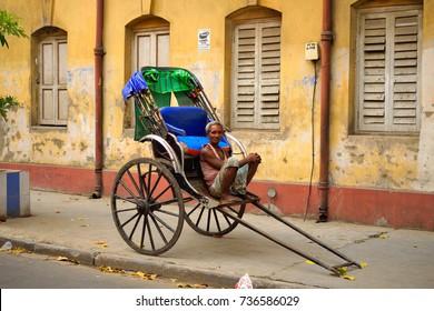 Kolkata, India - July 09, 2017: A hand rickshaw puller waits for passengers in his rickshaw.