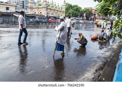 Kolkata, India - June 25, 2017: A street scene on the day of Eid, a Muslim festival. A handicapped beggar is standing on street asking for alms.