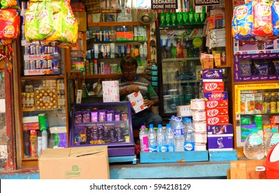 Kolkata, India - March 04, 2017: A man selling wide variety of items in his grocery shop.